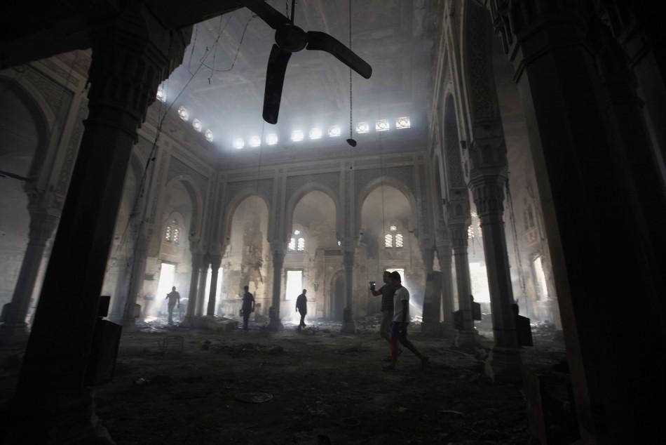 People walk inside the burnt Rabaa Adawiya mosque. (Photo: Reuters)