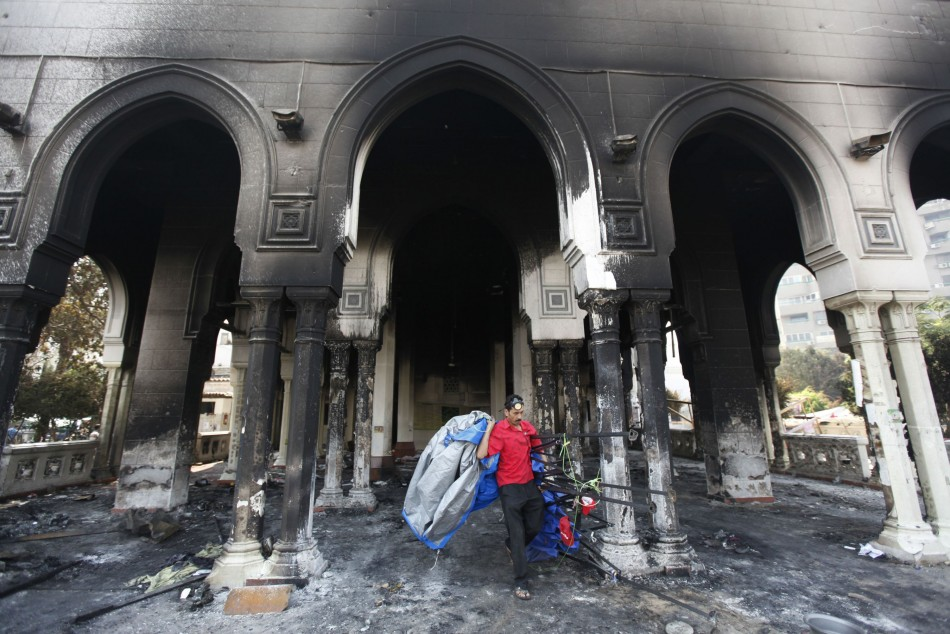 A man walks outside the burnt Rabaa Adawiya mosque following a security forces crackdown in Cairo. (Photo: Reuters)