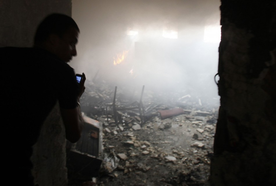 A man uses a phone to record events in the Rabaa Adawiya mosque complex. (Photo: Reuters)