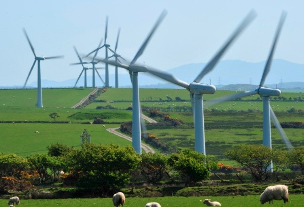 A windfarm is seen on Anglesey, north Wales. Britain's government is still investing millions into the renewable energy sector. (Photo: Reuters)