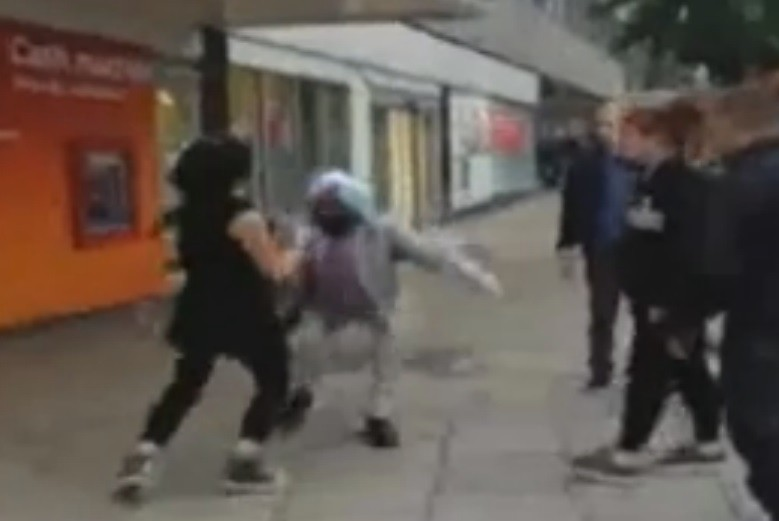 Female thug shoves Sikh on to ground in Coventry
