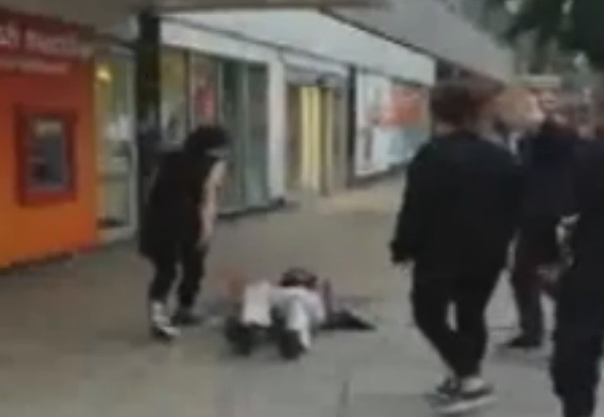Young woman continues abusing OAP after pushing him to the ground