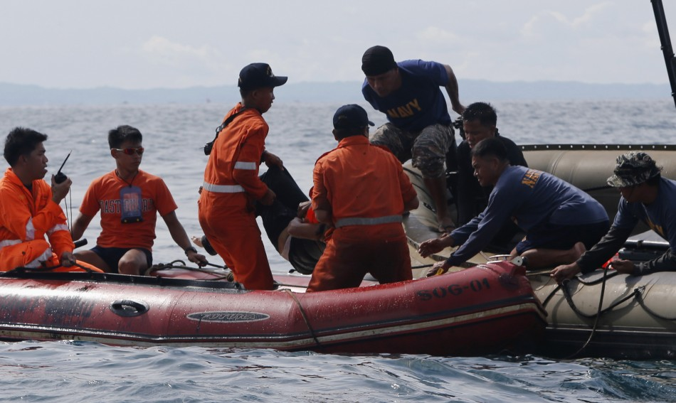 A Philippine ferry sank after colliding with a container ship, killing at least 24 people with more than 200 missing