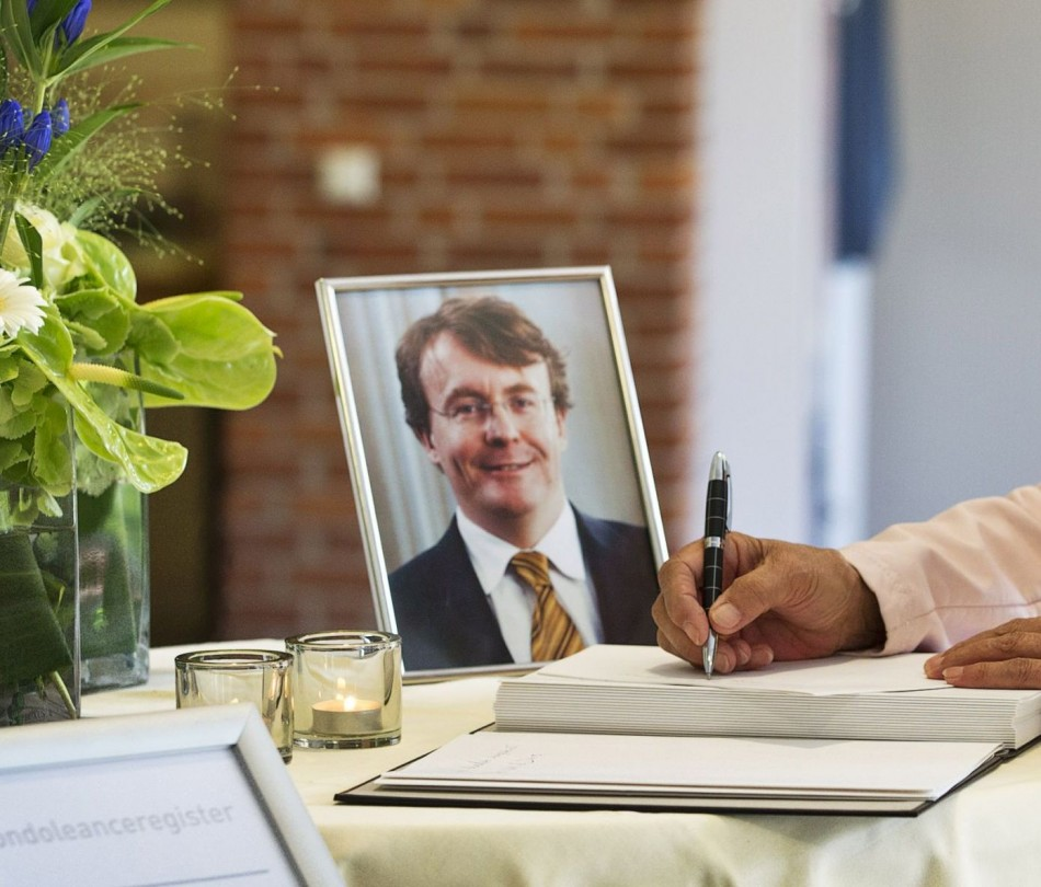 A woman signs the condolence register for Prince Johan Friso of the Netherlands at the town hall of Ermelo August 13, 2013. Prince Friso, the brother of the new Dutch king, died on Monday in a royal palace in The Hague, 18 months after a skiing accident l