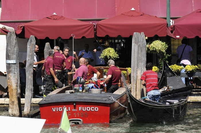 Firefighters transport a gondola after it crashed with a ferry boat at the Grand Canal in Venice, resulting in the death of a German tourist