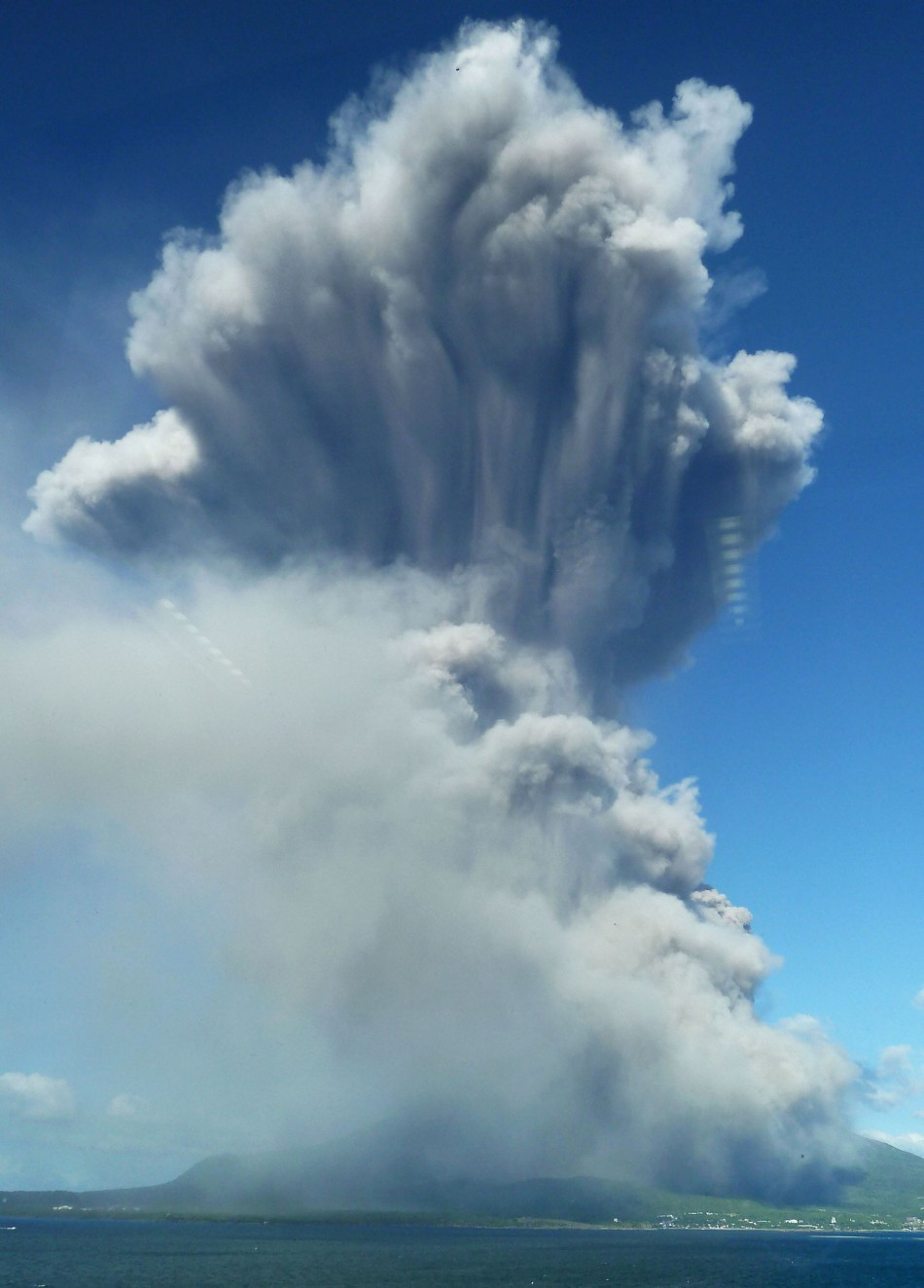 Smoke rises after an eruption of Mount Sakurajima in Kagoshima, southwestern Japan, in this photo taken through a window by Kyodo August 18, 2013. The eruption on Sunday of the 1,117-metre (3665-feet) high volcano, one of Japan's most active volcanoes, se