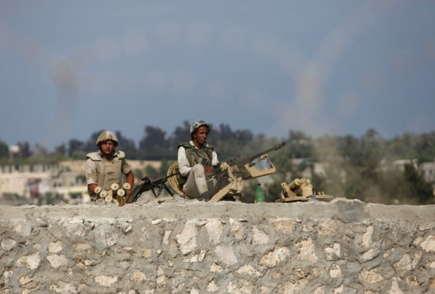 Egyptian soldiers keep guard on the border between Egypt and southern Gaza Strip