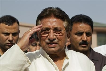 Pervez Musharraf salutes as he arrives at a court hearing