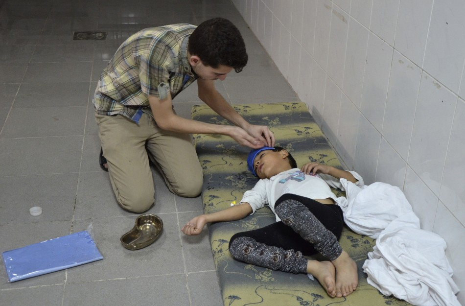 A boy, affected by what activists say was a gas attack, is treated at a medical center in the Damascus suburbs of Saqba,