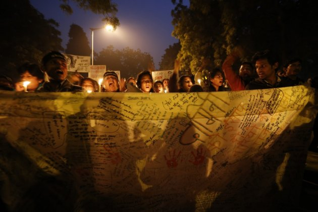 Demonstrators hold a banner with their signatures during a candlelight march for a gang rape victim, who was assaulted in New Delhi January 16, 2013. A 23-year-old physiotherapy student was raped and beaten in Delhi on December 16, prompting millions of I