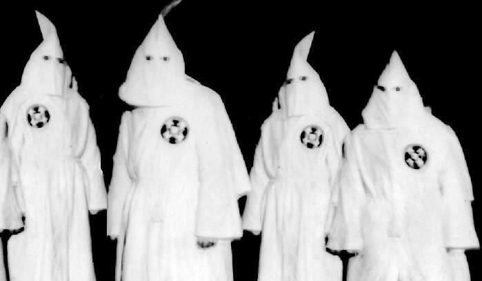 Ku Klux Klan members in full hooded regalia