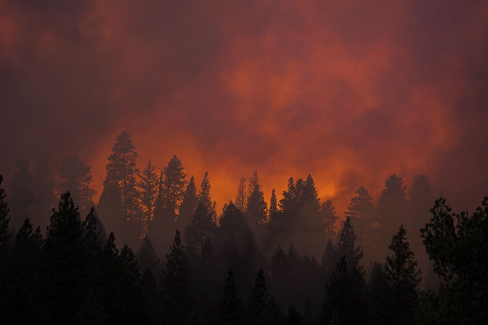 The sun sets on the Rim Fire near Buck Meadows, California. (Photo: Reuters)