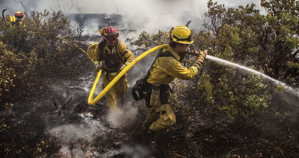A firefighting crew puts out a spot fire that jumped a fire line in Yosemite National Park. (Photo: Reuters)