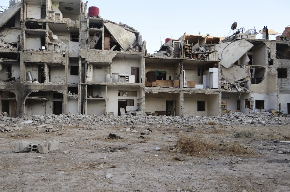 Buildings damaged by shells in Damascus