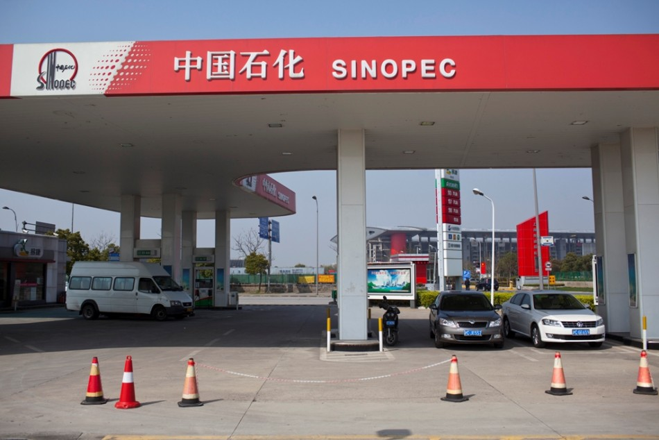 Cars are seen parked at a Sinopec gas station in Shanghai