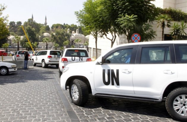 United Nations (U.N.) vehicles transport a team of U.N. chemical weapons experts to the scene of a poison gas attack outside the Syrian capital last week