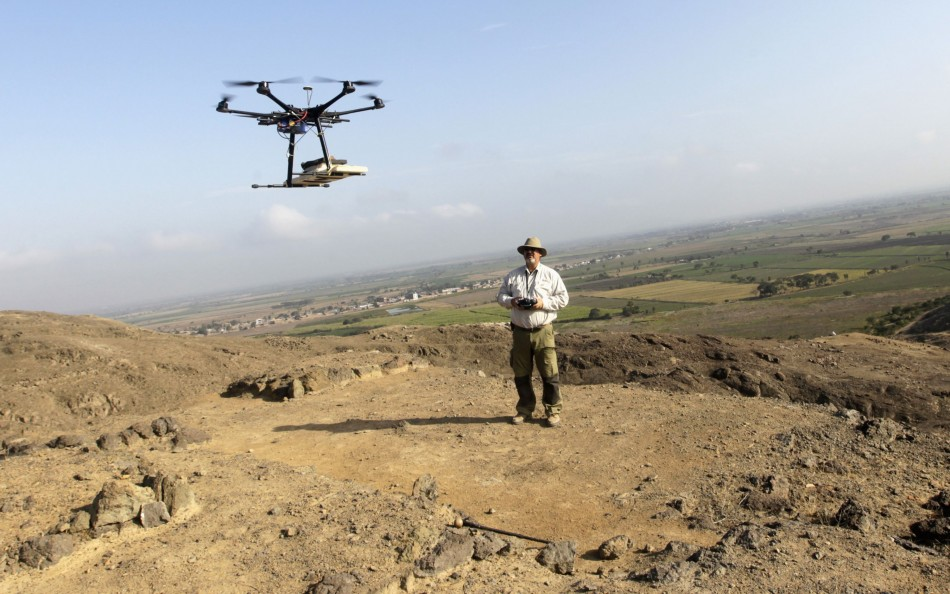 Luis Jaime Castillo, a Peruvian archaeologist with Lima's Catholic University and incoming deputy culture minister, flies a drone over the archaeological site of Cerro Chepen in Trujillo August 3, 2013. (Reuters)