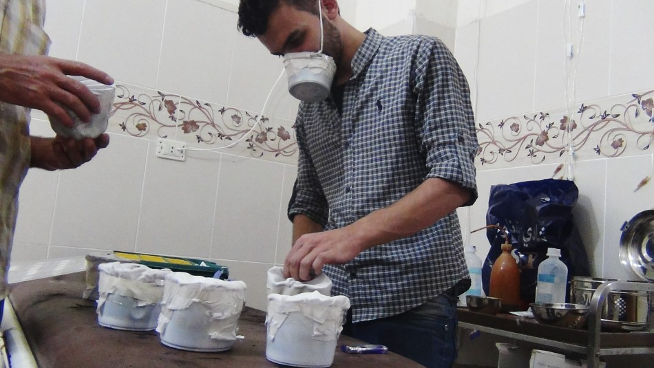 Activists and medics manufacture homemade chemical masks in Damascus' suburbs of Zamalka