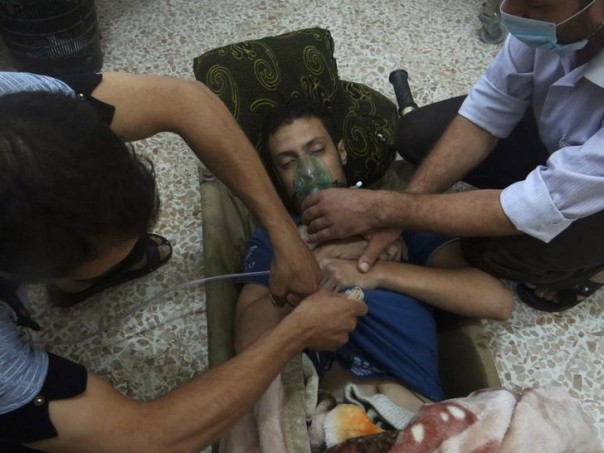 An emergency response team attends to a chemical attack victim in Syria