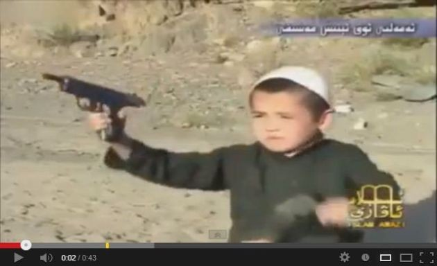 Screenshot of a video shows a boy firing guns from a pistol at Al-Qaida's terrorist camp in Afghanistan. (YouTube)