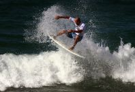 Eleven-time world surfing champion Kelly Slater of the USA rides a wave during a promotional event at Sydney's Manly Beach. (Reuters)