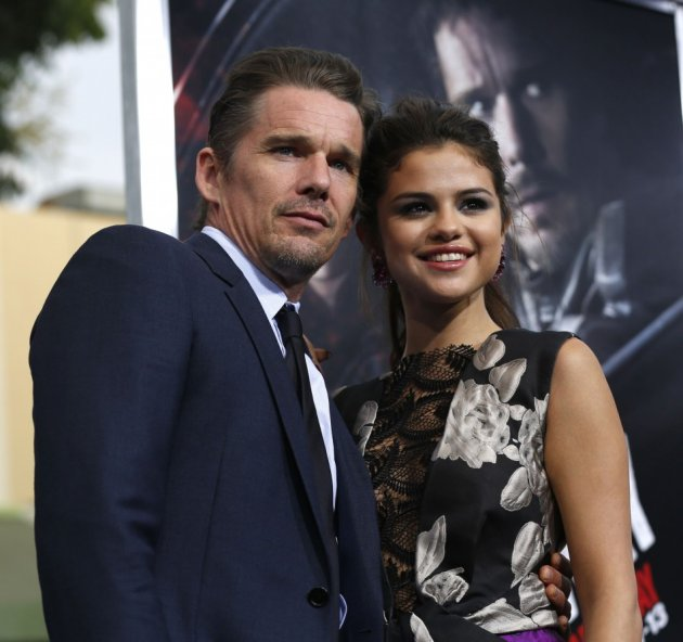 Cast members Ethan Hawke and Selena Gomez pose at the premiere of