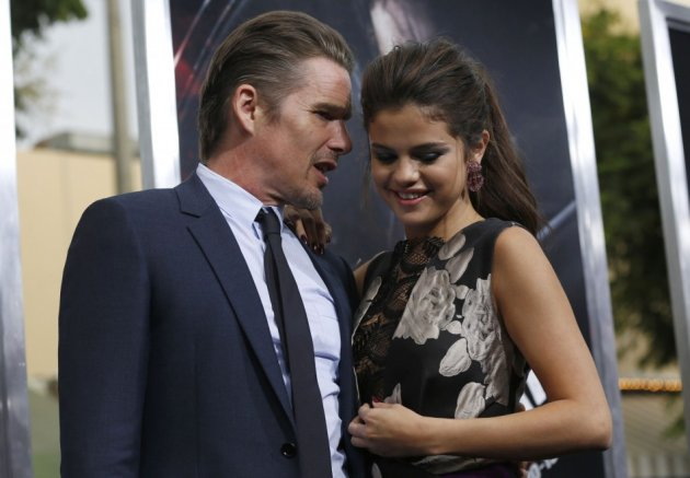 The international singing sensation, Selena Gomez struck a chord with co-star Ethan Hawke as they stood close at the premiere of Getaway in Los Angeles. (Reuters)