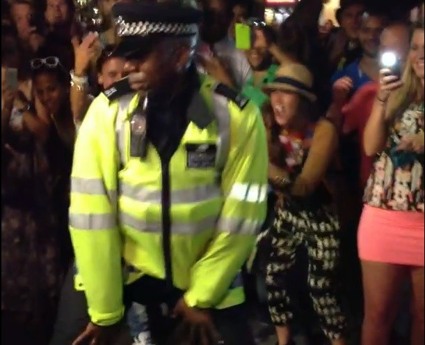 Police officer twerks at Notting Hill Carnival 2013 in London PIC: YouTube MOOFBulleh