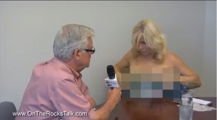 Canadian Journalist Goes Topless During Interview