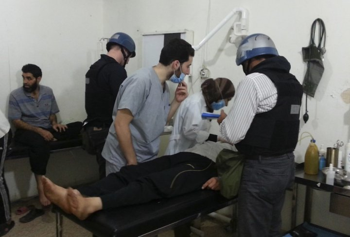 U.N. chemical weapons experts visit people affected by an apparent gas attack, at a hospital in the southwestern Damascus suburb of Mouadamiya