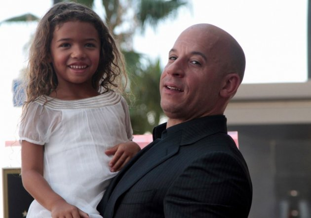 Actor Vin Diesel poses with his daughter Hania Riley during a ceremony to unveil his star on the Hollywood Walk of Fame in Hollywood, California, August 26, 2013.