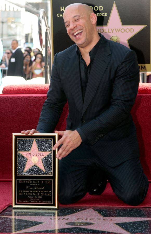 Actor Vin Diesel poses with his newly unveiled star on the Hollywood Walk of Fame in Hollywood, California, August 26, 2013.