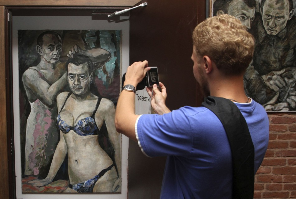 A visitor takes a picture of the controversial artwork at the Muzei Vlasti (Museum of Authorities) in St. Petersburg August 15, 2013. (Reuters)