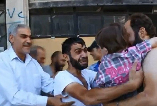 Father and son reunited after poison gas attack in Damascus PIC: YouTube
