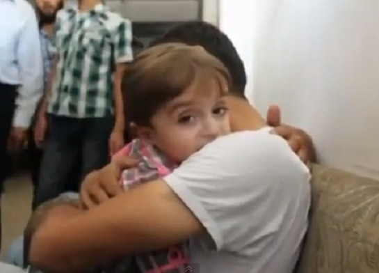 Father and son reunited after Damascus poison gas attack PIC: YouTube