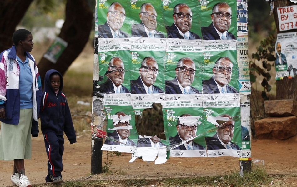 Images of Zimbabwe president Robert Mugabe still litter towns after last month's election PIC: Reuters
