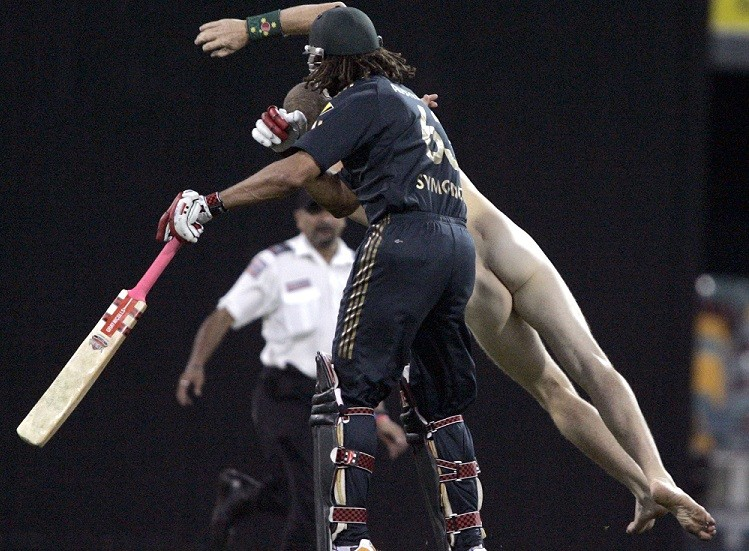 Andrew Symonds tackles streaker at the Gabba ground in 2008 PIC: Reuters
