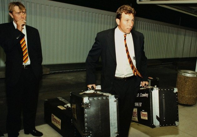 Phil Tufnell (l) in relaxed mood, as skipper Michael Atherton takes the bags during England's troubled tour of New Zealand