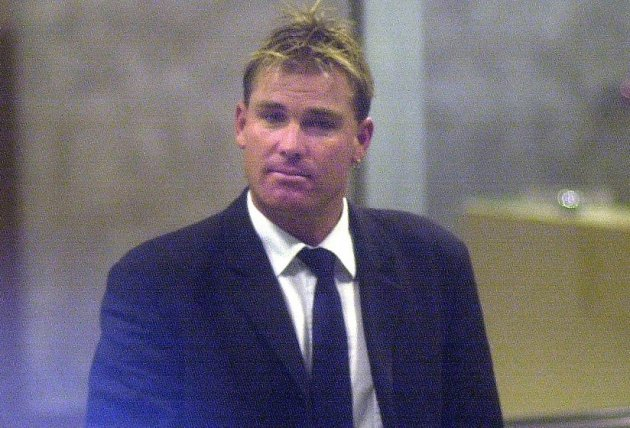 Chastened Shane Warne exits a meeting Australian cricket bosses after testing positive for a banned substance PIC: Reuters