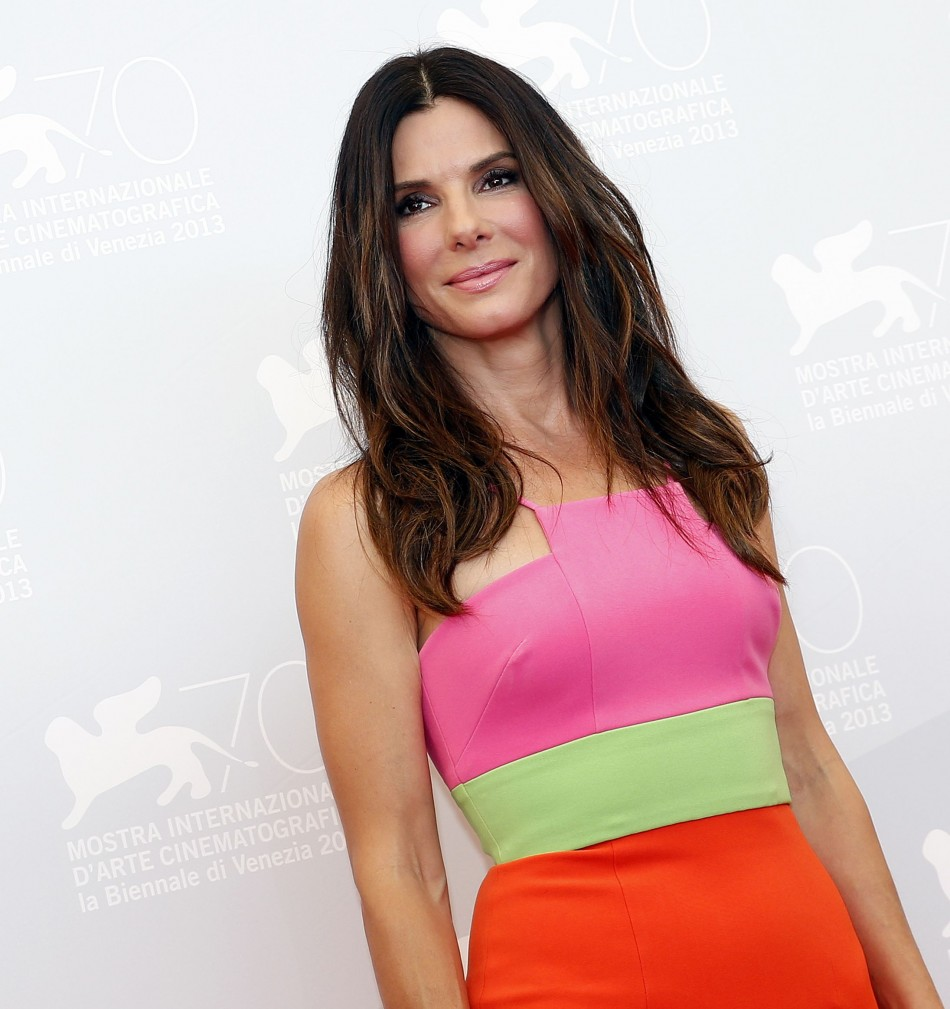 Sandra Bullock, 49, didn't opt for any accessories but  nude heels. (REUTERS/Alessandro Bianchi)