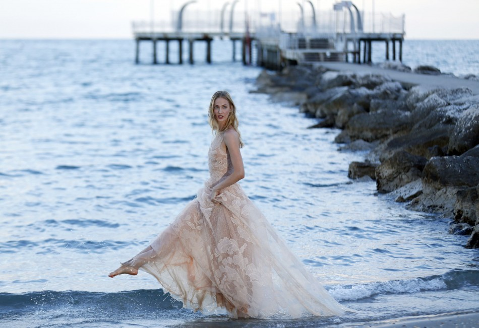 Eva Riccobono poses a day before the 70th Venice Film Festival in Venice August 27, 2013. Riccobono hosted the opening ceremony for the film festival. She will be hosting the closing ceremony as well. (REUTERS/Alessandro Bianchi)