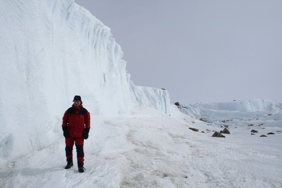 Norway's Prime Minister Jens Stoltenberg studies glacier