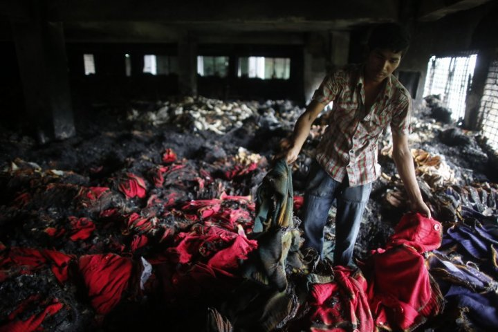 Sweat shop workers risk burning to death in factory fires like this one in Dkara PIC: Reuters