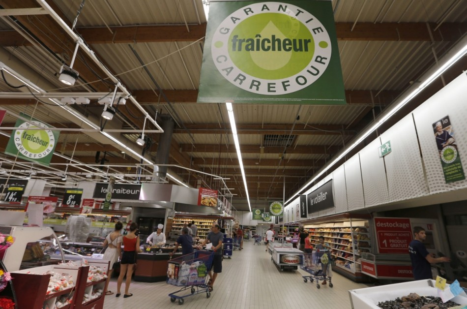 Customers shop in an aisle at a Carrefour hypermarket in Brive-La-Gaillarde, central France. (Reuters)