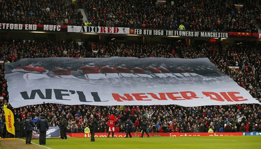 A banner is unfurled at Old Trafford to commemorate the 55th anniversary of the Munich air crash (Reuters)