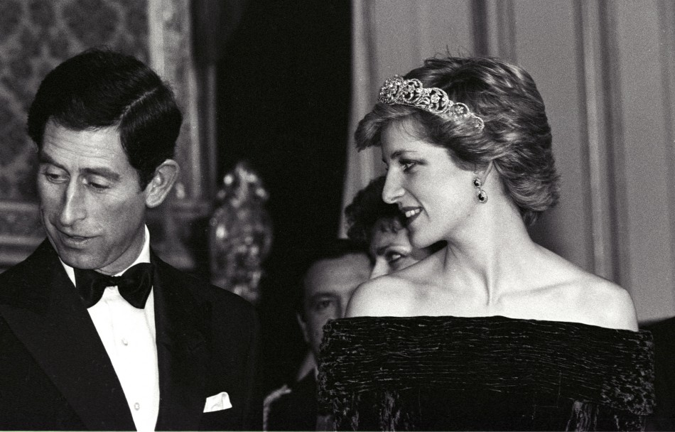 This photo perhaps shows the love Diana had for Prince Charles, for she ardently looks at him at a Banquet held at the Ajuda palace in Lisbon February 12, 1986. (REUTERS)