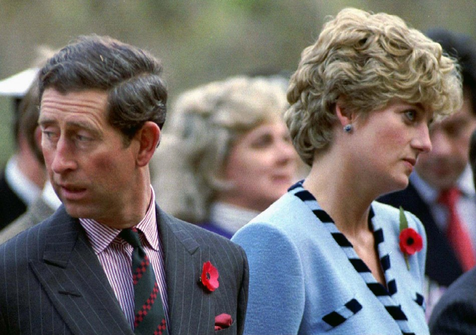 This photo speaks about the strained relationship between Diana and Prince Charles. They look in different directions during a Korean War commemorative service in November 1992. (Reuters)