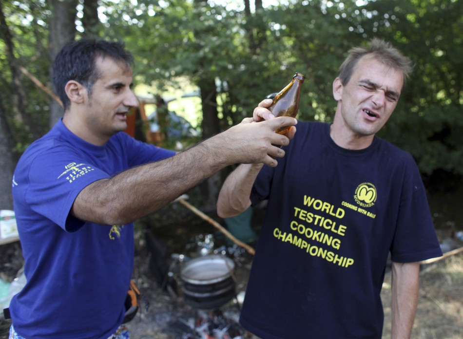 Testicle eaters use alcohol to wash out their mouths at Serbia's Testicle Cooking Championships PIC: Reuter