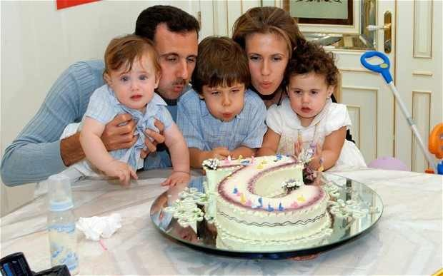 Syrian president with wife and three children