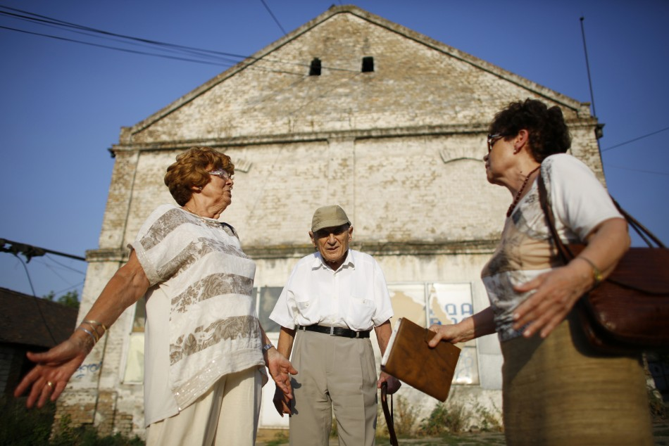 Lucija Rajner (L), Marijana Sibinovic (R) and Teodor Kovac talk on the site where their fathers were interned in Topovske Supe, a WWII-era Nazi concentration camp for Jews in Serbia's capital Belgrade